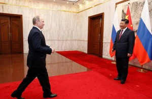 Il presidente russo Putin con il leader cinese Jinping - How Hwee Young Getty Images