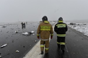 A Russian Emergency Ministry employee at the site of the crash - photo AP