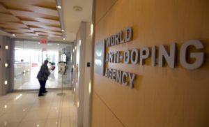 A woman walks into the head office for the World Anti-Doping Agency (WADA) in Montreal, November 9, 2015. An international anti-doping commission recommended on Monday that Russia's Athletics Federation be banned from international competition over widespread doping offences - a move that could see the powerhouse Russian team excluded from next year's Rio Olympics. Russian sports minister said there was no evidence for the accusations against the Federation. REUTERS/Christinne Muschi       TPX IMAGES OF THE DAY