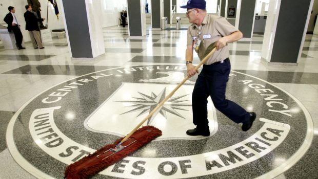 The logo of the U.S. Central Intelligence Agency is swept clean prior to remarks there by U.S. President George W. Bush in the lobby of the CIA headquarters in Langley, Virginia March 3, 2005. U.S. President George W. Bush visited the headquarters for briefings Thursday. REUTERS/Jason Reed  JIR - RTR3VKR