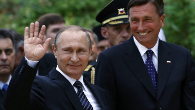 Russian President Vladimir Putin, left, and Slovenia's president Borut Pahor attend a ceremony at a Russian Chapel in Kranjska Gora, Slovenia, Saturday, July 30, 2016. Slovenia, which has joined sanctions against Russia for its annexation of Crimea and meddling in Ukraine, has been very careful to portray Putin's visit on Saturday as strictly informal and not against the EU policies. (AP Photo/Darko Vojinovic)