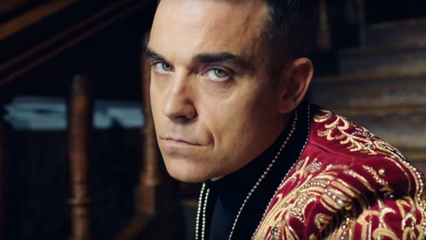 Robbie Williams has been accused of racism by Russian media, with one paper claiming he will never perform in Russia again